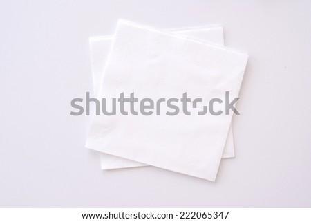paper napkins on bright background - stock photo