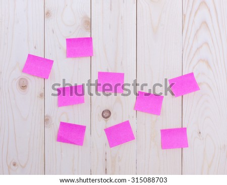 Paper note color pink on wood background - stock photo