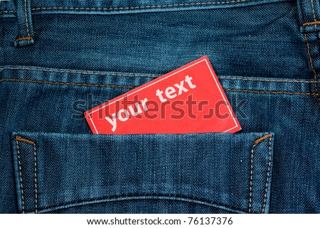 paper note in jeans back pocket with copy space - stock photo