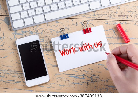 Paper note with text Work with us - stock photo