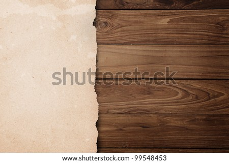 paper on wooden background. - stock photo