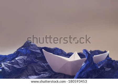 Paper origami ship in storm, danger concept - stock photo