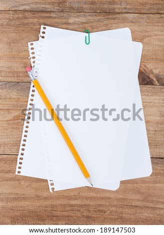 paper page notebook. and pencil isolated on the white backgrounds.  - stock photo