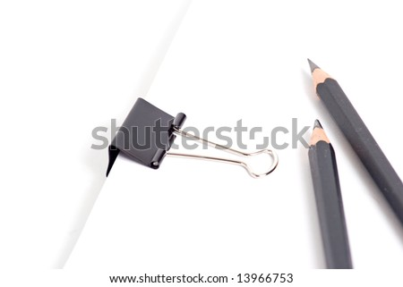 Paper, pencil and clip supplies - stock photo