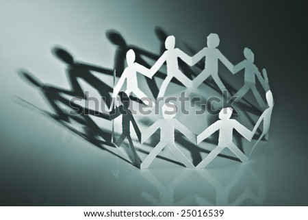 paper people in circle closeup - stock photo