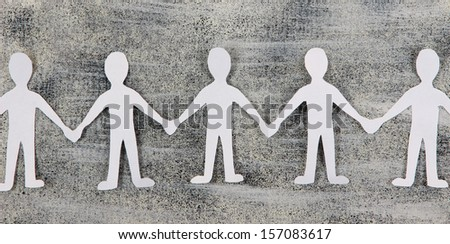 Paper people in social network concept on grey background - stock photo