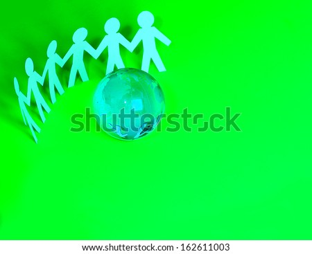 paper people standing around glass globe. conceptual idea for family, unity, and teamwork.  - stock photo