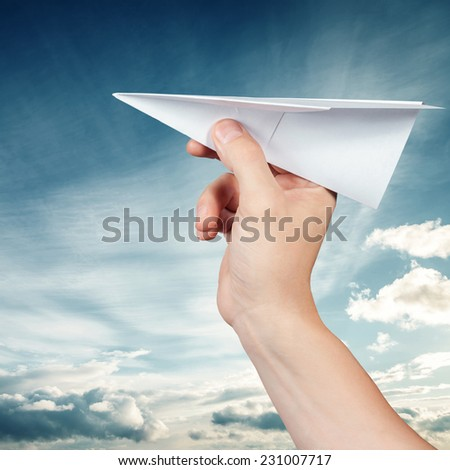 Paper plane against the blue sky - stock photo