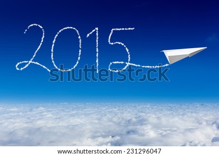 Paper plane flying and drawing 2015 in the sky. happy new year 2015 - stock photo