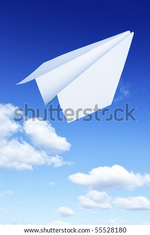Paper plane flying. Sky and clouds in the background - stock photo