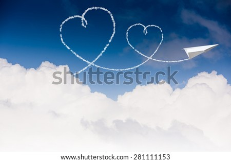 Paper plane flying with the heart shapes in the sky - stock photo