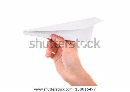 Paper Plane in a Hand Isolated On The White Background - stock photo