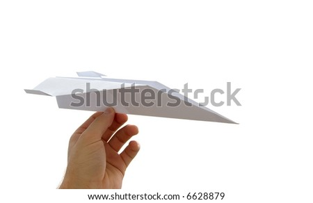 Paper plane in a hand isolated on white - stock photo