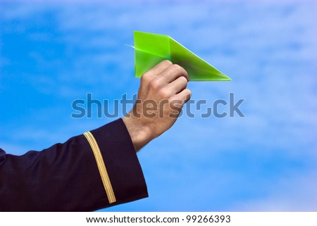 Paper plane in hand - Big children's dream became a reality - stock photo
