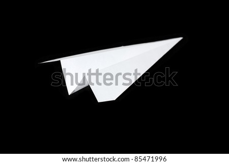 Paper planes in black background - stock photo