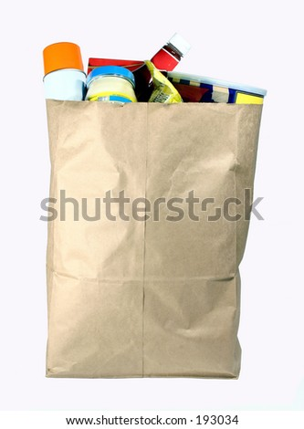 Paper sack full of groceries.  Isolated on white. - stock photo