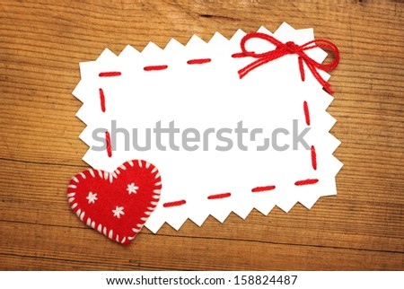 Paper Sheet and Christmas  heart on wooden background - stock photo