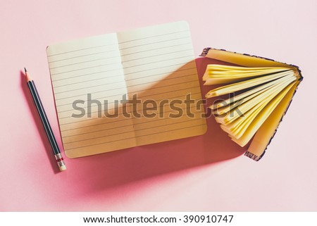 Paper sheet, notebook and pencil on pink paperboard, top view - stock photo