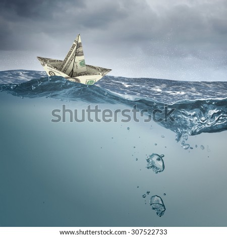 Paper ship floating on water on stormy waves - stock photo