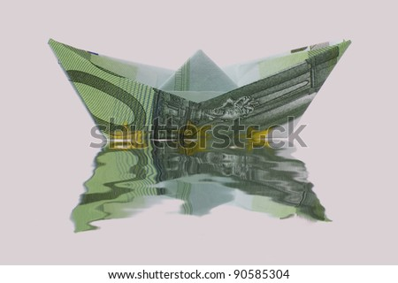 Paper ship made of euro banknote sailing on water - stock photo