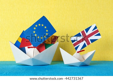 paper ship with Flags of European Union (flags of different countries eurozone) and United Kingdom, Brexit UK EU referendum concept. concept shipment or free trade agreement and membership.  - stock photo