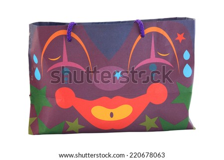 paper shopping bag with joker face isolated on white background - stock photo