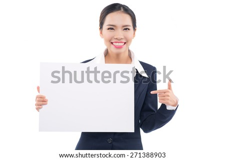 Paper sign business woman smiling. Cute lovely fresh girl advertising your product on blank white sign board. Asian Caucasian female model isolated on white background. - stock photo