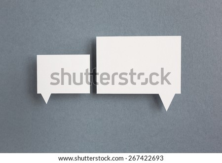 paper speech bubbles on grey background - stock photo