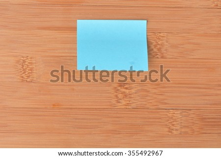Paper sticky note on wall - stock photo