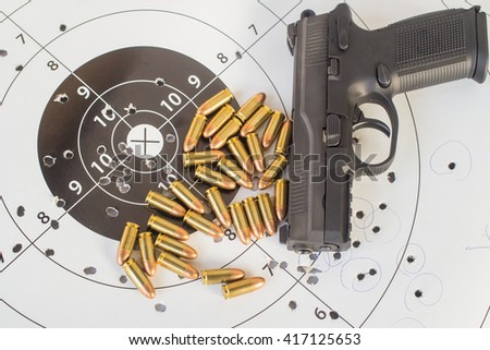 paper target gun pistol magazine - stock photo