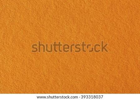 Paper texture, orange kraft sheet background. - stock photo