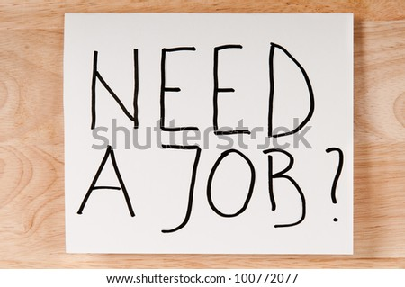 Paper with inscription marker NEED A JOB. - stock photo