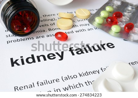 Paper with kidney failure and pills. Medical concept. - stock photo