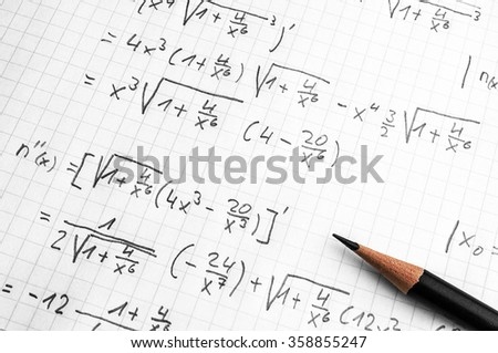 paper with maths-formulas and a pencil - homework concept - stock photo