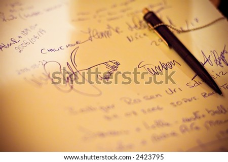 Paper with signs and pen - stock photo