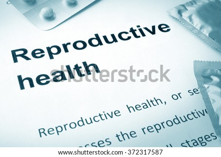 Paper with words reproductive health and contraceptives. - stock photo
