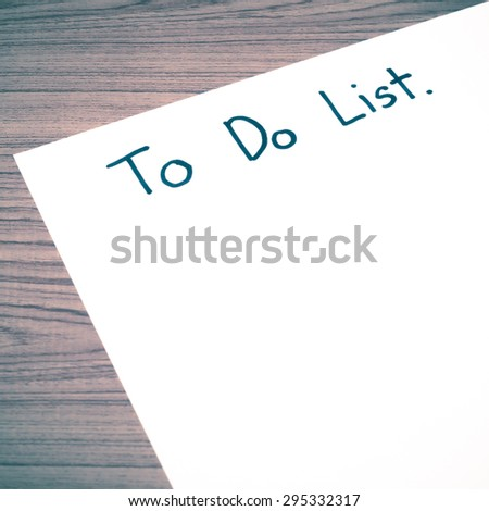 paper write to do list word on wood background vintage style - stock photo