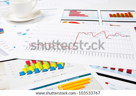 papers and charts of successful business, workplace of the businessman - stock photo