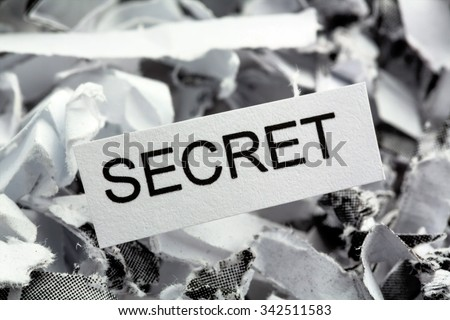 papierschnitzel tagged secret, symbol photo for data destruction, banking secrecy and industrial espionage - stock photo