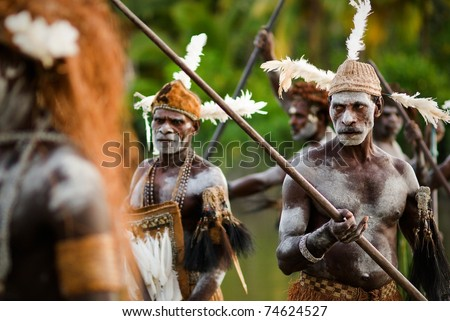 PAPUA (IRIAN JAYA), ASMAT PROVINCE, INDONESIA : JANUARY 18: Asmat headhunters display traditional and national tribal customs, dresses, and weapons on January 18, 2009 in Papua (Irian Jaya), Asmat Province, Indonesia. - stock photo