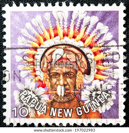 PAPUA NEW GUINEA - CIRCA 1978: A used postage stamp from Papua New Guinea illustrating Native man is tribal dressing, issued in 1978. - stock photo