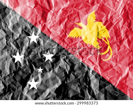 Papua New Guinea flag painted on crumpled paper background. - stock photo