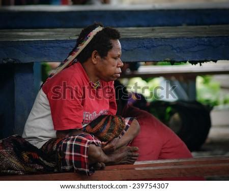 Papua Province, Indonesia - January 2011: A traditional papua woman on the market in Wamena at New Guinea Island.  - stock photo