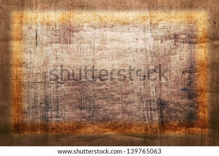 papyrus - vintage paper with space for text or image with lighting frame - stock photo