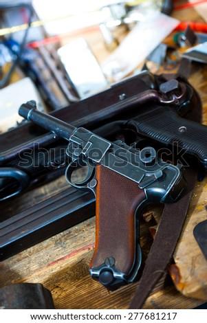 Parabellum pistol and mashinegun MP 38 in gunsmith - stock photo