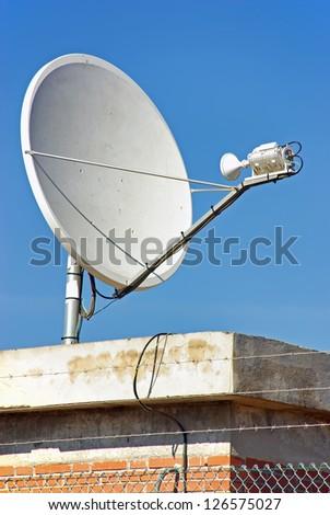 Parabollic Antenna to receive satellite signal - stock photo