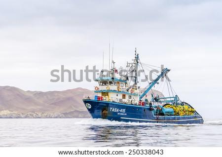 PARACAS, PERU, MAY 22, 2014: Fishing boat in Islas Ballestas region - stock photo