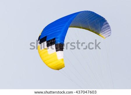 parachute on a sky background - stock photo