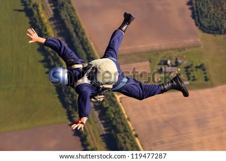 Parachutist falling - stock photo