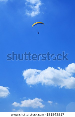 parachutist flight - Feeling free on the blue sky - stock photo
